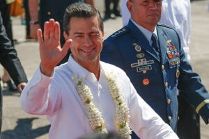 Mexican President Enrique Peña Nieto winks to the crowd after his arrival at the Villamor Air Base in Pasay City on Tuesday. President Nieto will be attending the Asia Pacific Economic Cooperation meeting with 20 other leaders of member-economies on November 18-19 in Manila.(MNS photo)